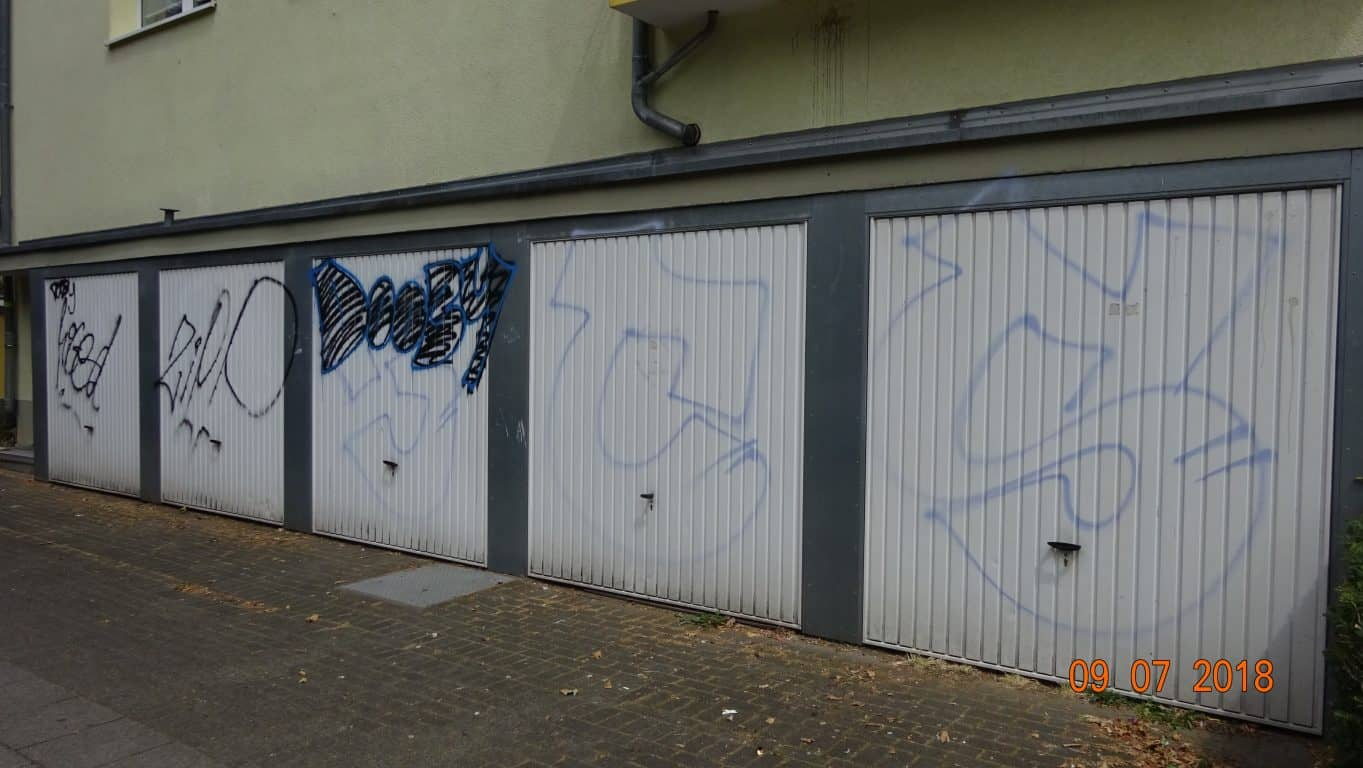 Graffitientfernung Garagentor Koeln